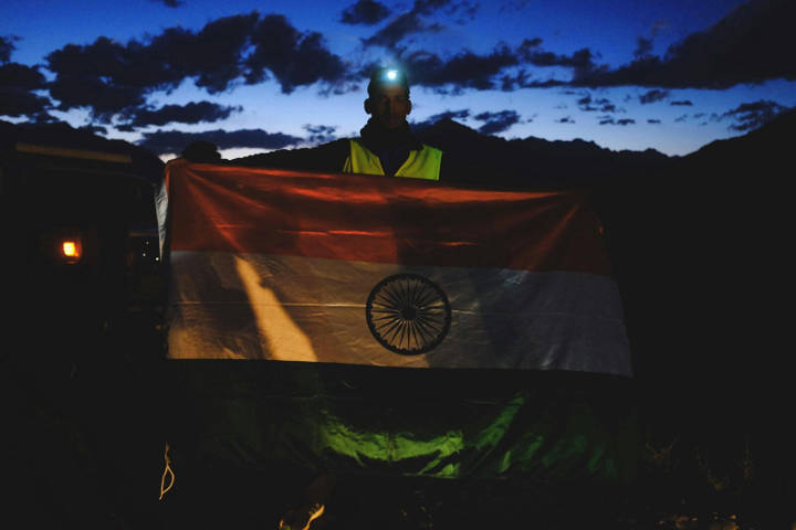 Parvez Malik holding the Indian flag at the start line of the sixth edition of La Ultra - The High.