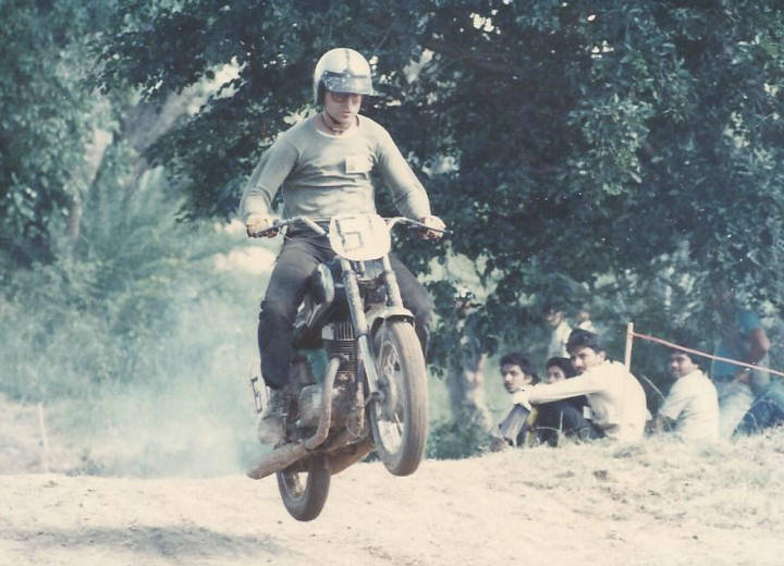Riding a Yezdi 250cc motorcycle in a motocross event in Bangalore in the mid 1980s.